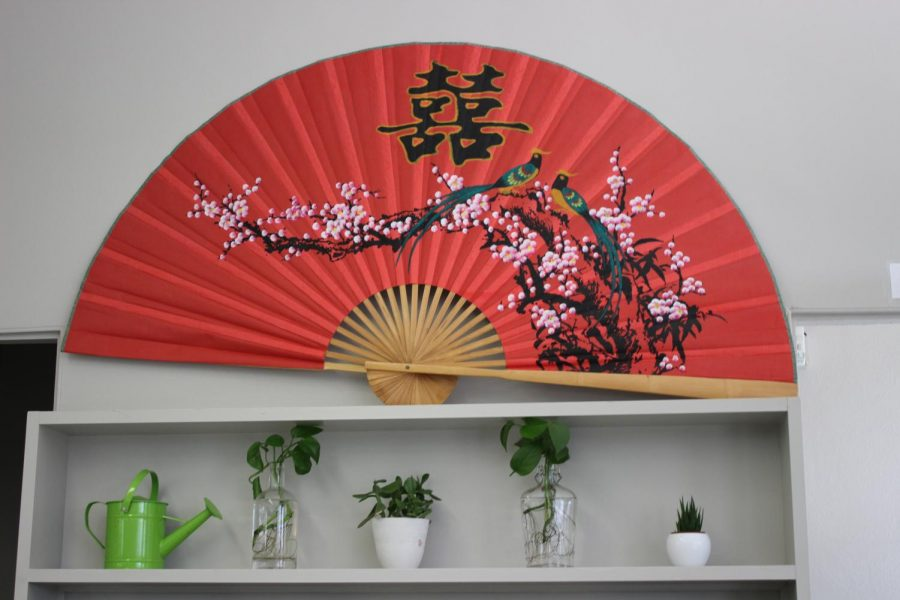 A large fan styled in Japanese fashion greets students in Ms. Hoffman's plant filled room.