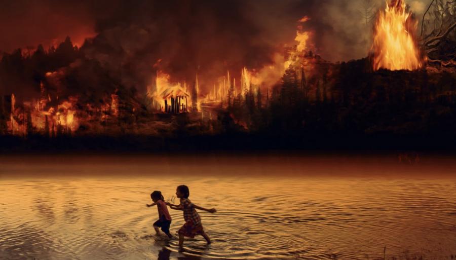 Children running through a river next to a fire.