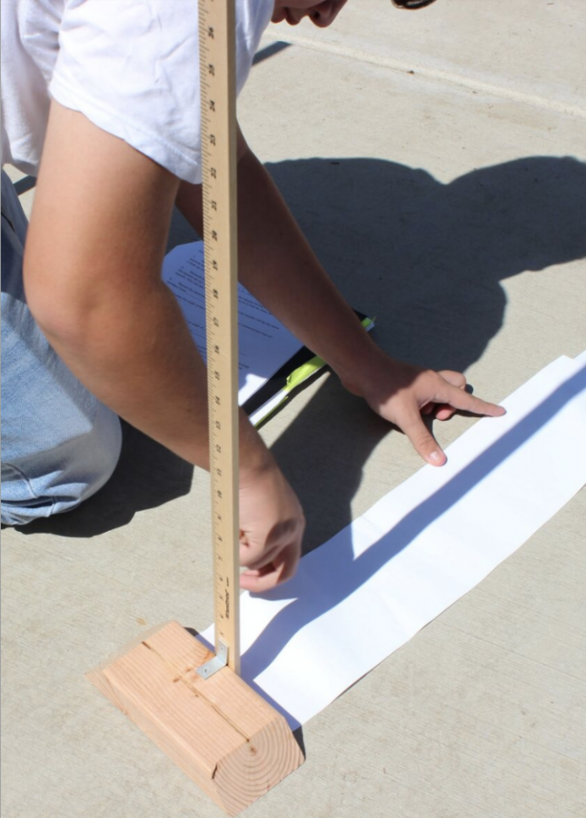 A student uses a ruler and paper to make measurements just like Eratosthenes 2,200 years ago.