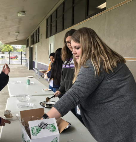 Ms. Sprague and Angelina Martinez pass out pie to people who have participated in the Pi Day challenge.
