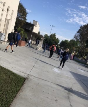 Highschool students in Orange County following COVID-19 school guidelines as they walk to their next class