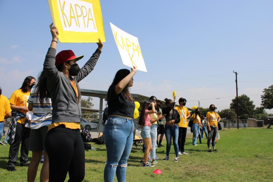 Juniors Isabella Zepeda (left) and Angel Mancinas (right) cheer on Kappa in their game against Delta.