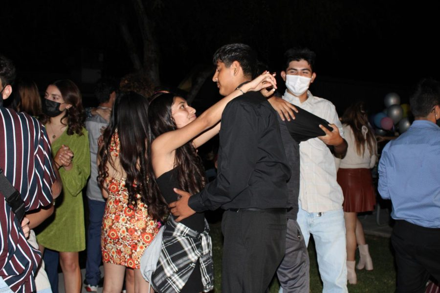 Lanayah Perez, freshman, and her guest dance partner, Mario Carillo, gaze into each others eyes during the one and only slow dance of the night.