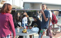 Students wearing pajamas on bottom and outwear clothing on top for Zoom day.