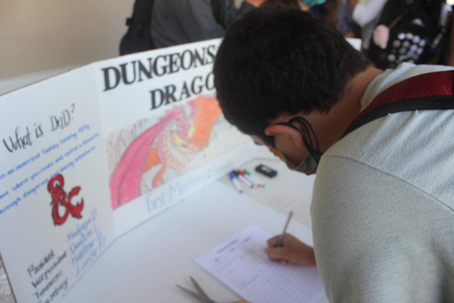 Ollie MacDonald, sophomore, signs up for the Dungeons & Dragons club.