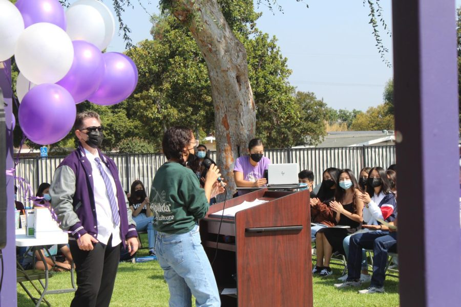 Payton Zarceno, ASB president, gives the announcements after the ceremony for next week's friendship week and first dance of the year.